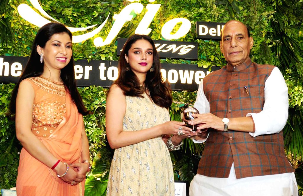 Union Home Minister Rajnath Singh giving away the Young Women Achievers Awards 2017-18 to actress Aditi Rao Hydari during a function organised by the FICCI in New Delhi on April 6, 2018. - Rajnath Singh and Rao Hydari