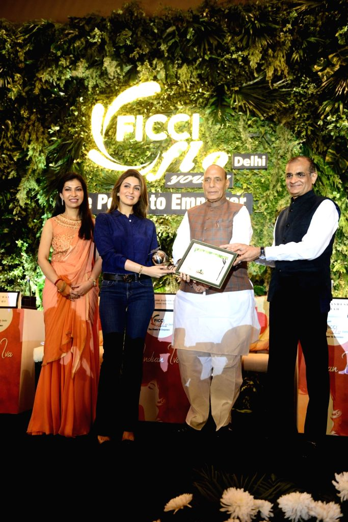 Union Home Minister Rajnath Singh giving away the Young Women Achievers Awards 2017-18 to jewellery designer Riddhima Kapoor Sahani during a function organised by the FICCI in New Delhi on ... - Rajnath Singh and Riddhima Kapoor Sahani