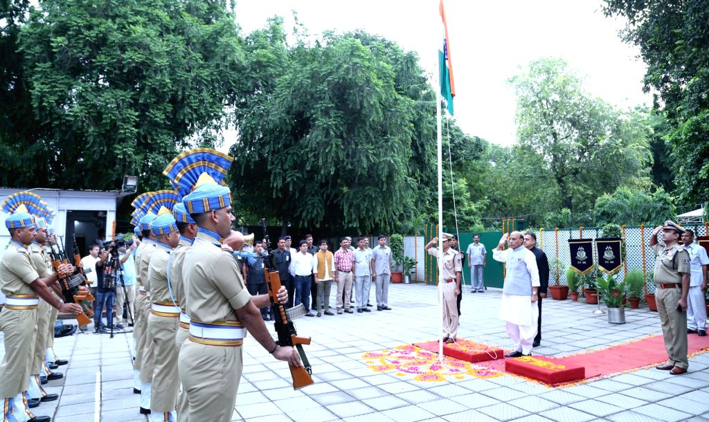 Union Home Minister Rajnath Singh hoisting the national flag on 70th Independence Day celebrations, in New Delhi on Aug 15, 2016. - Rajnath Singh