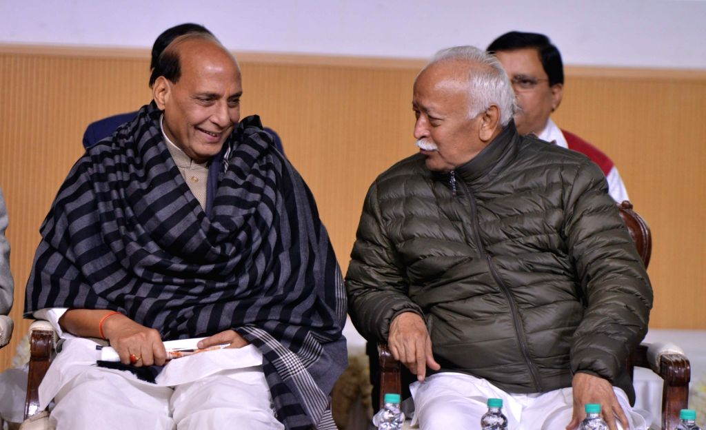 Union Home Minister Rajnath Singh in a conversation with Rashtriya Swayamsevak Sangh (RSS) chief Mohan Bhagwat during a condolence meeting organised to pay tributes to writer Devendra ... - Rajnath Singh