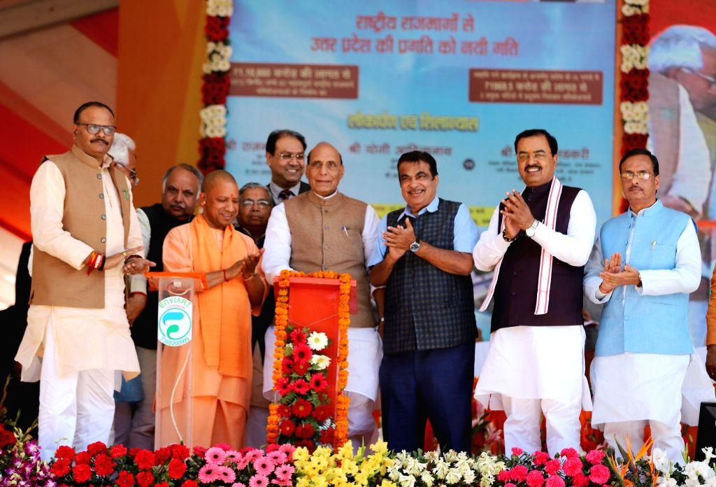 Union Home Minister Rajnath Singh inaugurates various development projects, in Lucknow, on March 7, 2019. Also seen Union Transport Minister Nitin Gadkari, Uttar Pradesh Chief Minister Yogi ... - Rajnath Singh