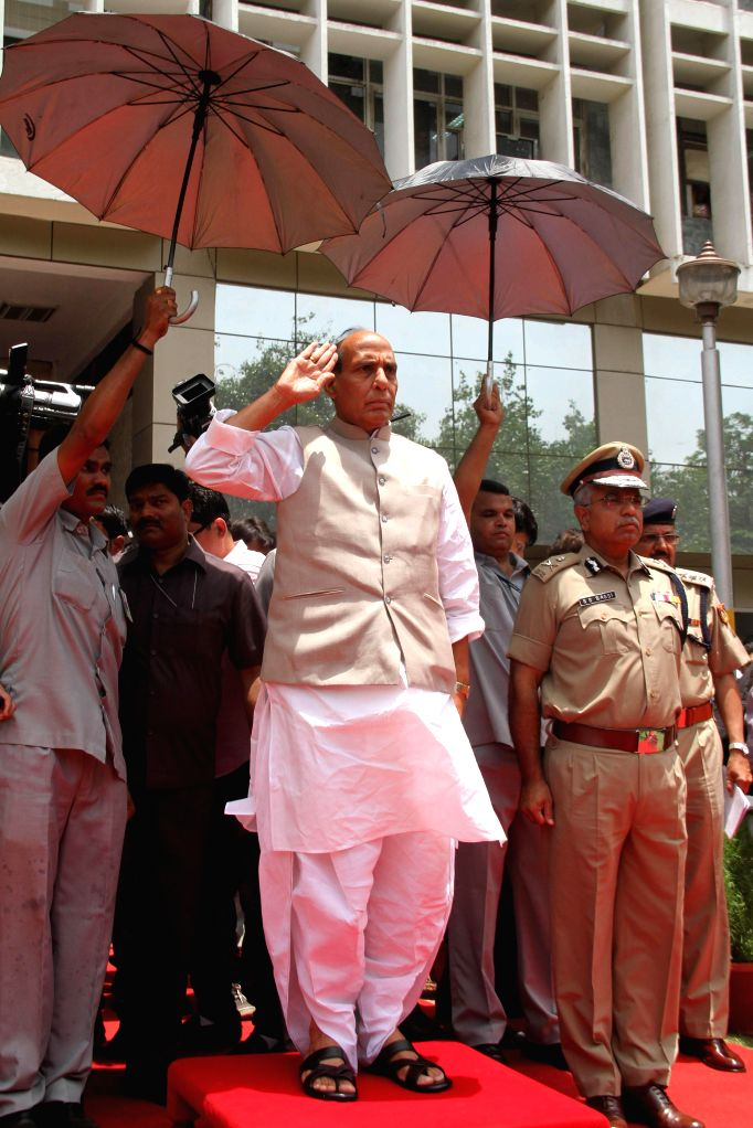 Union Home Minister Rajnath Singh inspecting the Guard of Honour, at Police Headquarters, in New Delhi on June 16, 2014.