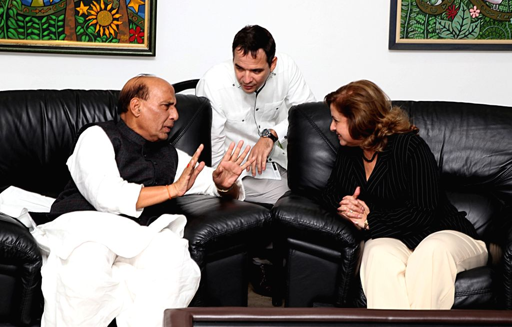 Union Home Minister Rajnath Singh interacts with the Cuban Minister of Justice Maria Esther Reus Gonzalez, on his arrival, at Havana airport on Nov 30, 2016. - Rajnath Singh