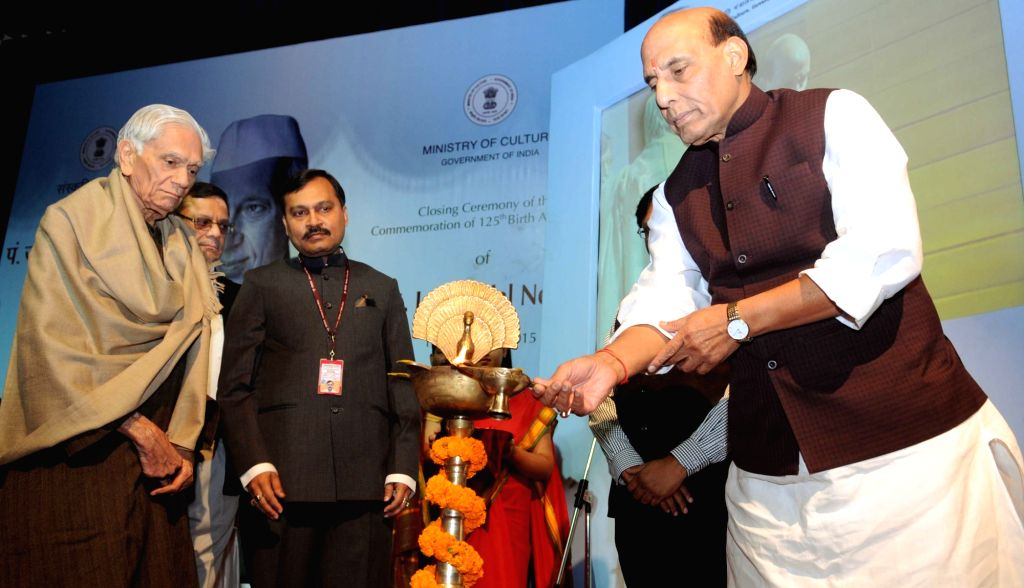 Union Home Minister Rajnath Singh lights the lamp at the closing ceremony of the commemoration of 125th Birth Anniversary of the former Prime Minister, Pandit Jawaharlal Nehru, in New ... - Rajnath Singh