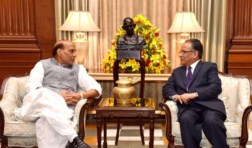 Union Home Minister Rajnath Singh meets Nepal's Prime Minister Pushpa Kamal Dahal in New Delhi on Sept 17, 2016. - Rajnath Singh