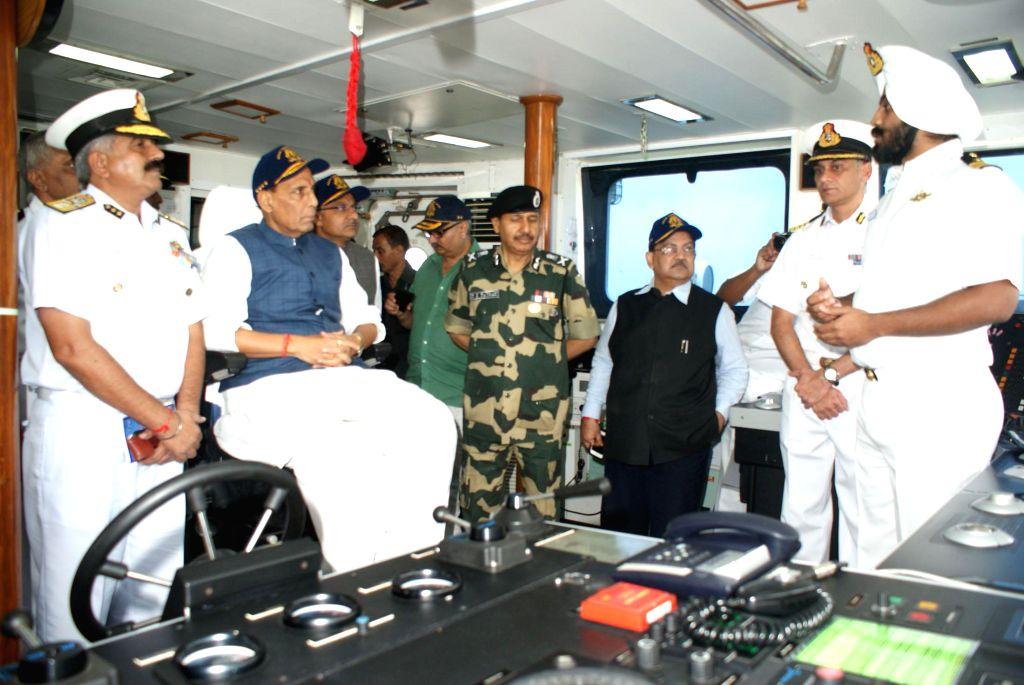 Union Home Minister Rajnath Singh onboard Coast Guard offshore patrol vessel ICGS Vijit in Porbandar of Gujarat on September 10, 2014.