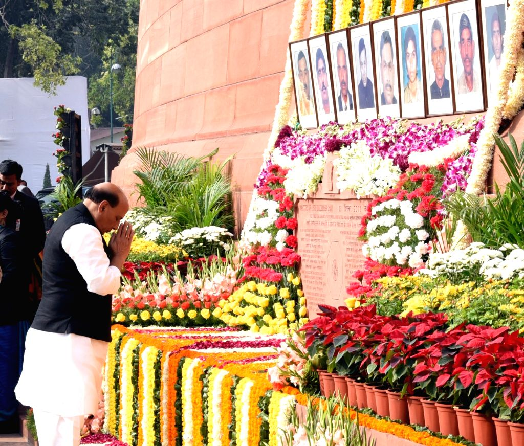Union Home Minister Rajnath Singh pays homage to the martyrs of the 2001 Parliament attack, in New Delhi, on Dec 13, 2018. - Rajnath Singh