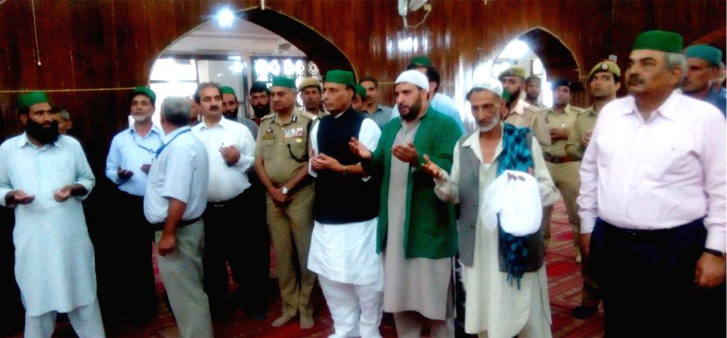 Union Home Minister Rajnath Singh pays obeisance at Hazratbal shrine, in Srinagar on July 2, 2016. - Rajnath Singh