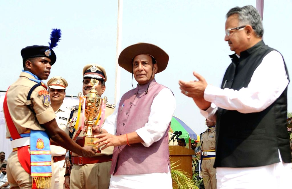 Union Home Minister Rajnath Singh presents trophies, during the Passing Out Parade of the 'Bastariya Battalion' of CRPF in Ambikapur, Chhattisgarh on May 21, 2018. Also seen ... - Rajnath Singh and Raman Singh