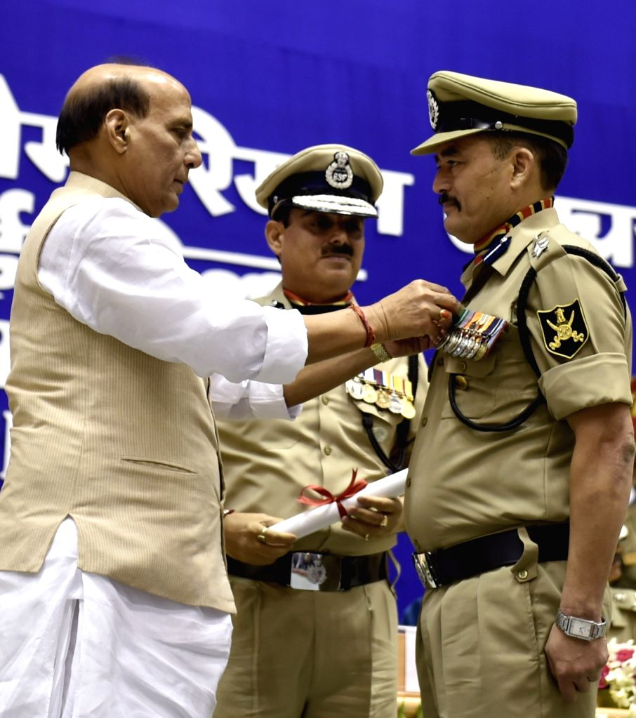 Union Home Minister Rajnath Singh presents police medal during 14th BSF Investiture Ceremony in New Delhi, on May 20, 2016. - Rajnath Singh