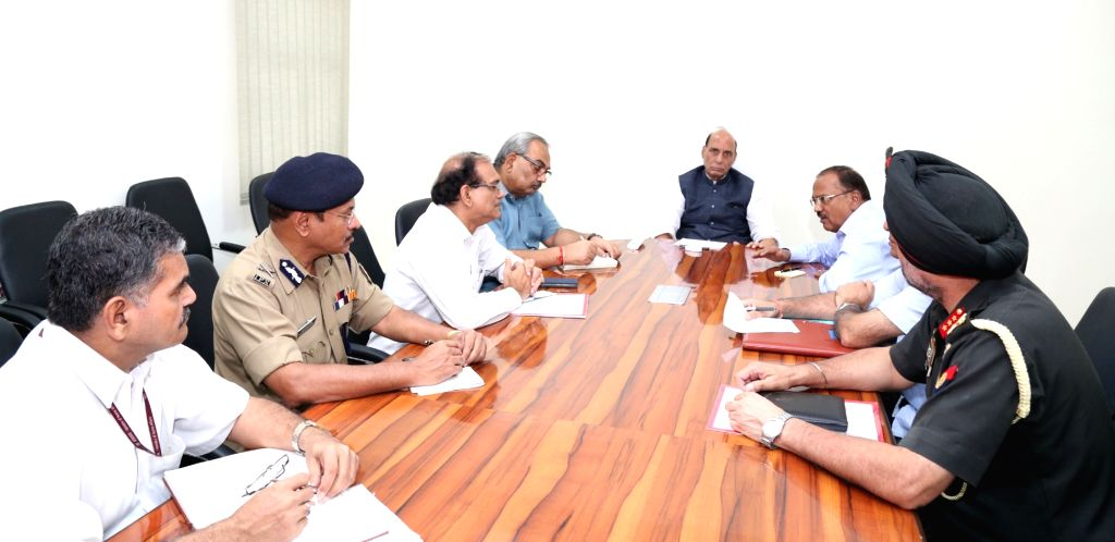 Union Home Minister Rajnath Singh reviews the security situation in Jammu and Kashmir in the wake of terror attack in Uri, in New Delhi on Sept 18, 2016. Also seen National Security ... - Rajnath Singh