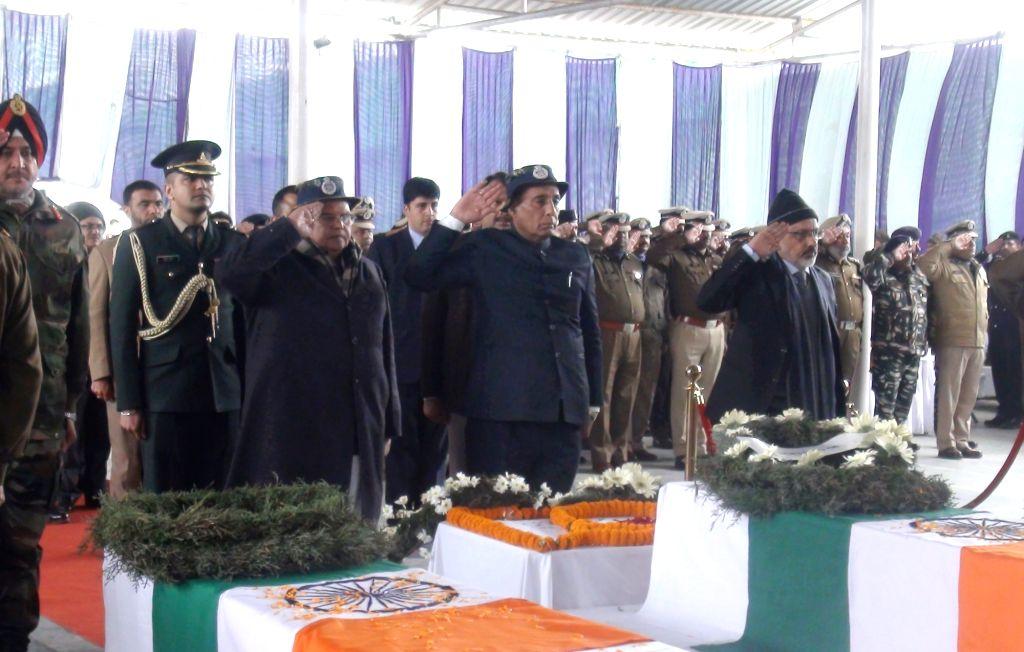 Union Home Minister Rajnath Singh saluting the martyred CRPF soldiers, at the Regional Training Centre, in Srinagar on Feb 15, 2019. Also seen Jammu and Kashmir Governor Satya Pal Malik, ... - Rajnath Singh, Malik, Rajeev Rai Bhatnagar and Ranbir Singh
