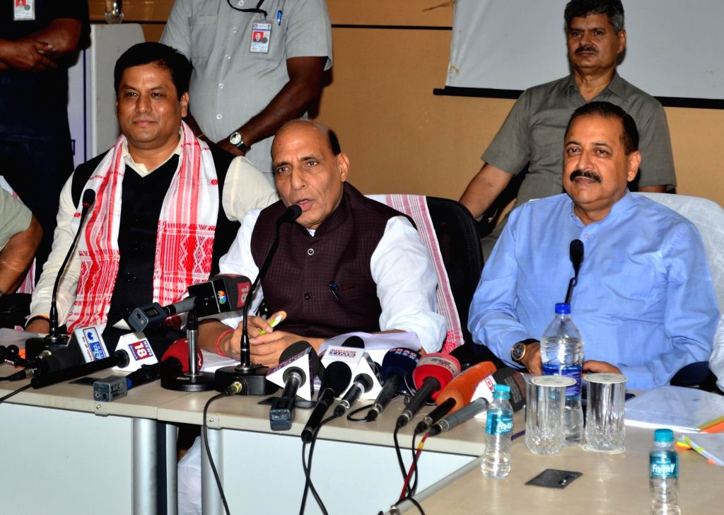 Union Home Minister Rajnath Singh talks to press after his visit to flood affected areas of Assam; in Guwahati on July 30, 2016. Also seen Assam Chief Minister Sarbananda Sanowal and Union ... - Rajnath Singh and Jitendra Singh