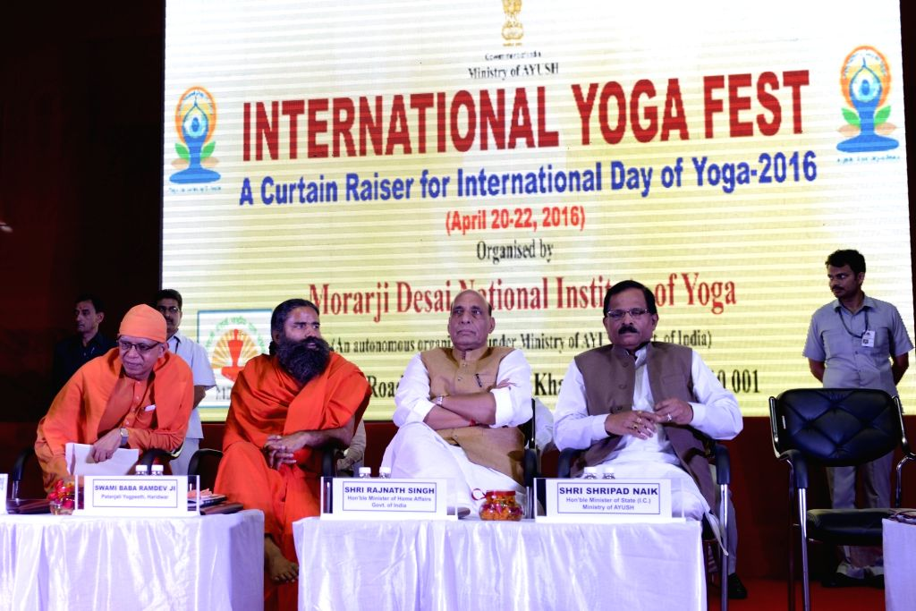 Union Home Minister Rajnath Singh, Union Minister of State for AYUSH Shripad Yesso Naik and Yoga Guru Ramdev during International Yoga Fest in New Delhi, on April 22, 2016. - Rajnath Singh