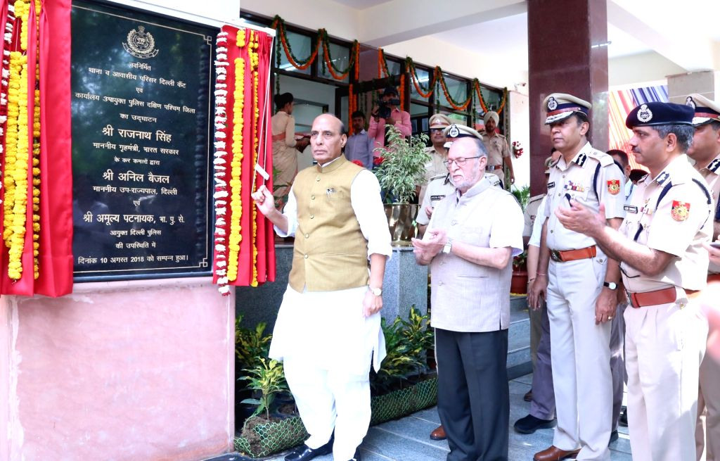 Union Home Minister Rajnath Singh unveils the plaque to lay foundation stone of the DCP South- West district, Police station Delhi Cantt. Office building and Delhi Police Residential ... - Rajnath Singh