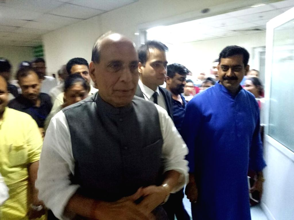 Union Home Minister Rajnath Singh visits injured BJP leader Brij Pal Teotia who was is in a critical state after assailants attacked his SUV on Rawli Road off NH-58 in Noida on Aug 13, 2016. - Rajnath Singh