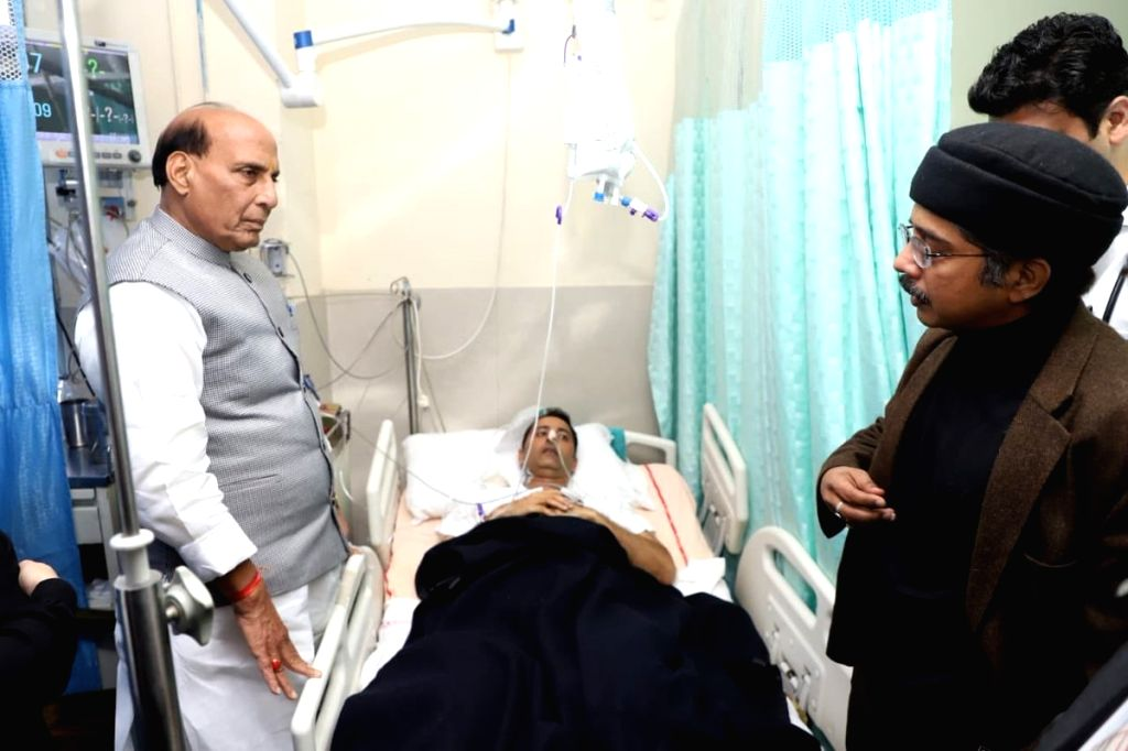 Union Home Minister Rajnath Singh visits the AIIMS trauma centre to inquire about the health of Jammu and Kashmir (J&K) Deputy Inspector General (DIG) Amit Kumar, who was injured in a ... - Rajnath Singh and Amit Kumar