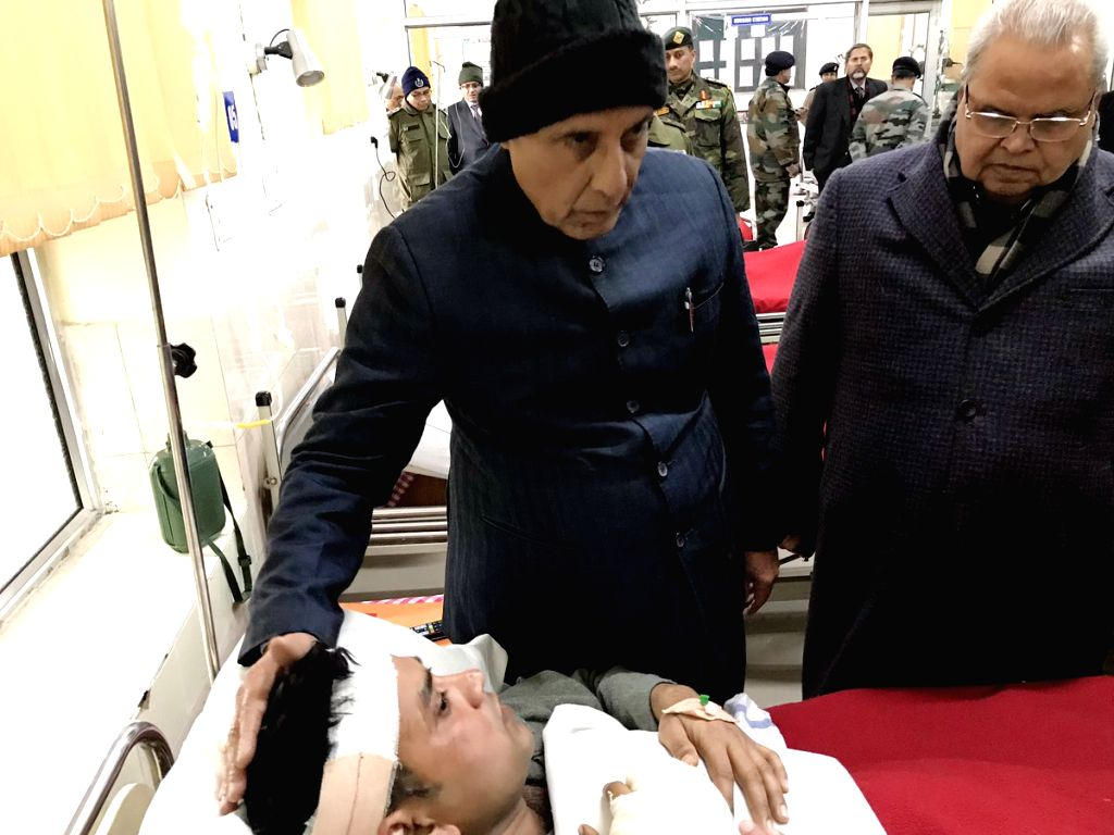 Union Home Minister Rajnath Singh visits the Army Hospital in Srinagar to inquire about the health of bravehearts who were injured in Pulwama terror attack; on Feb 15, 2019. Also seen Jammu ... - Rajnath Singh and Malik