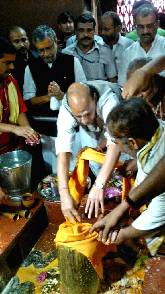 Union Home Minister Rajnath Singh worships lord Shiva at Hariharnath temple in Sonepur of Bihar on Aug 12, 2015.