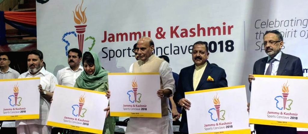 Union Home Minsiter Rajnath Singh along with Jammu and Kashmir Chief Minister Mehbooba Mufti, Union MoS PMO Jitendra Singh, Home Secretary Rajiv Gauba and other dignitaries releases the ... - Mehbooba Mufti and Jitendra Singh