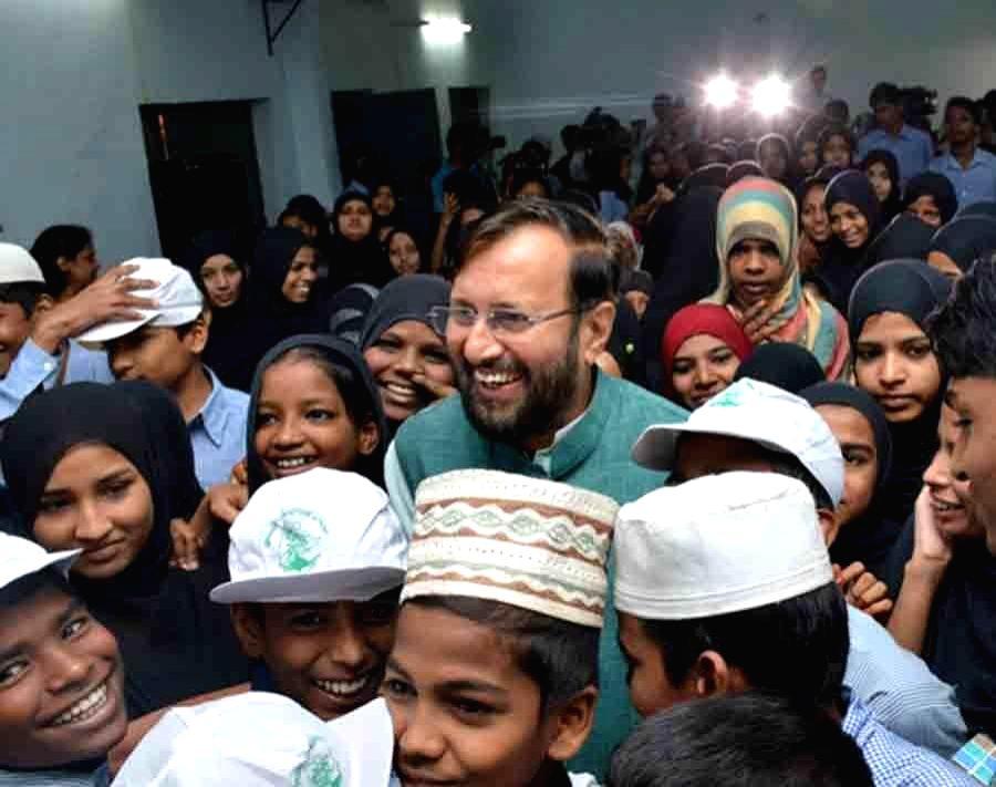 Union HRD Minister Prakash Javadekar interactswith the children of the Musheerabad Government Girls High School, in Hyderabad on Aug 13, 2016. - Prakash Javadekar
