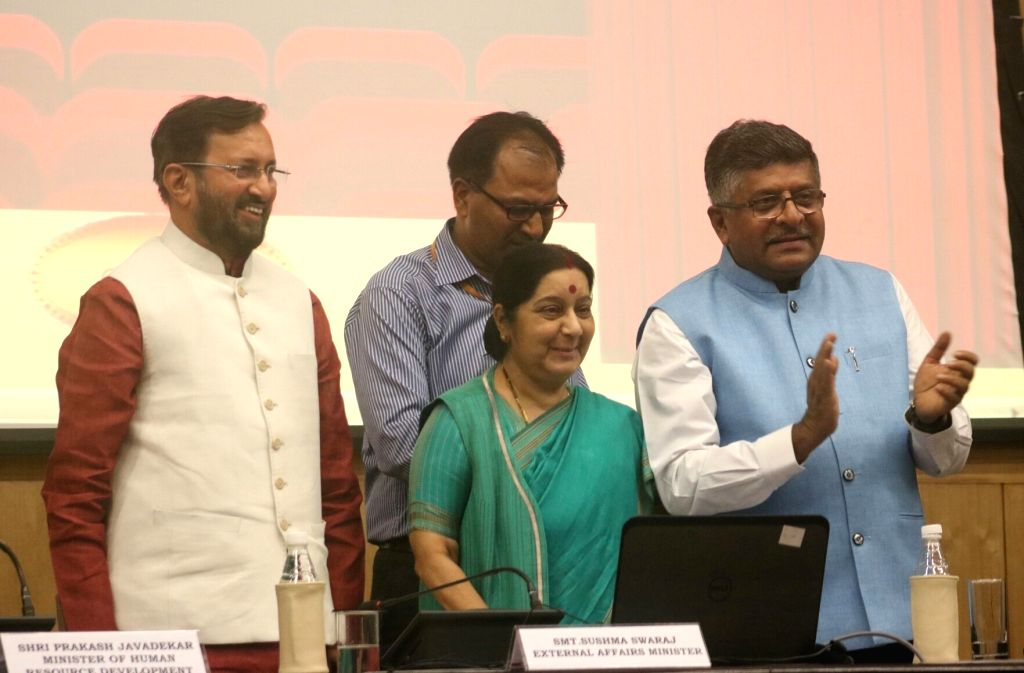 Union HRD Minister Prakash Javadekar, External Affairs Minister Sushma Swaraj and Union Information Technology Minister Ravi Shankar Prasad during a programme organised to launch ... - Prakash Javadekar and Sushma Swaraj