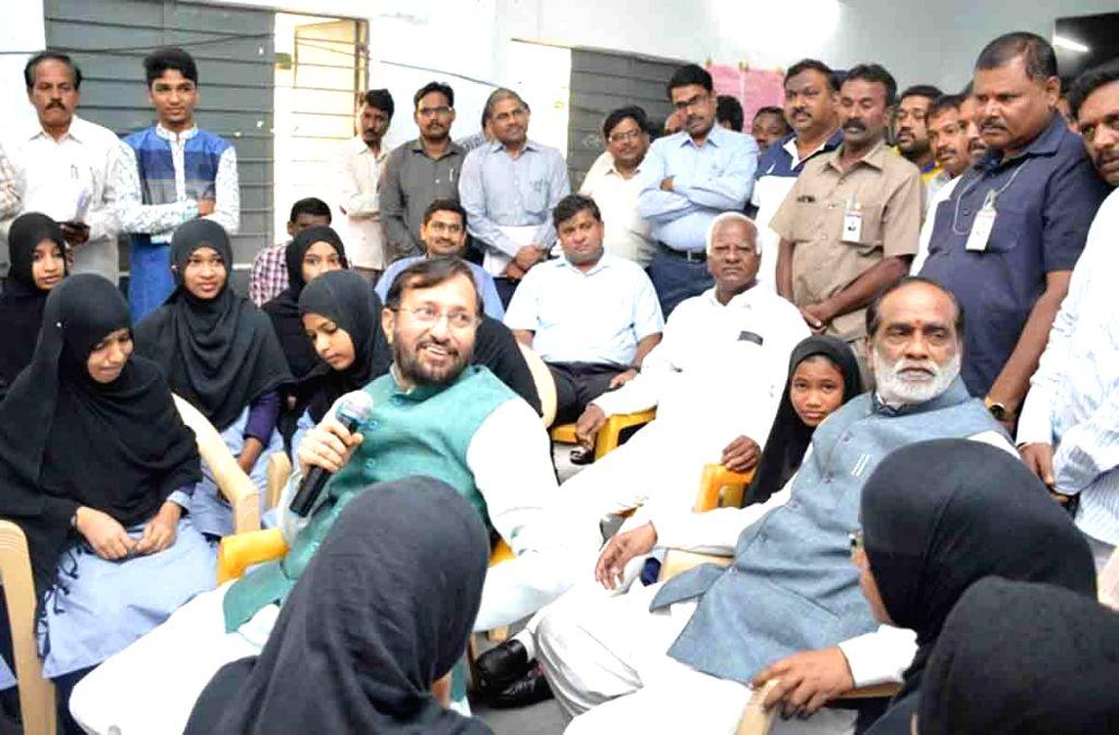 Union HRD Minister Prakash Javadekar interacts with the children of the Musheerabad Government Girls High School, in Hyderabad on Aug 13, 2016. - Prakash Javadekar