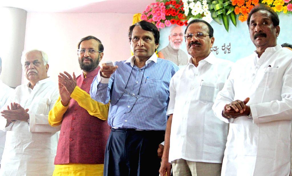 Union HRD Minister Prakash Javadekar, Railways Minister Suresh Prabhu and D. V. Sadananda Gowda during inauguration of renovated food plaza at Hubballi Railway Station on July 2, 2017. - Prakash Javadekar and Suresh Prabhu