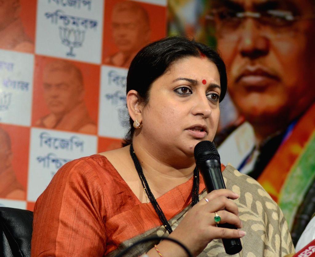 Union HRD Minister Smriti Irani addresses a press conference in Kolkata on April 6, 2018. - Smriti Irani