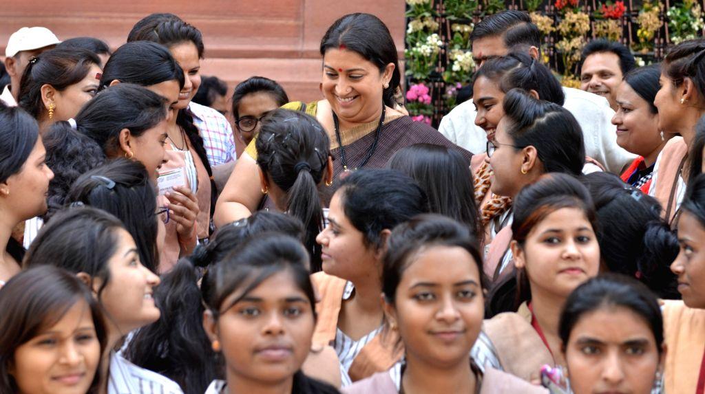 Union HRD Minister Smriti Irani with students at Parliament in New Delhi, on April 2, 2018. - Smriti Irani