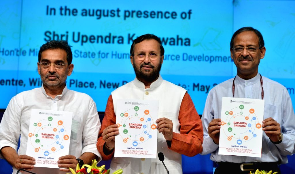 Union Human Resource Development (HRD) Minister Prakash Javadekar, Union MoS HRD Upendra Kushwaha and Union Education Secretary Anil Swarup during the launch of 'Samagra Shiksha', in ... - Prakash Javadekar