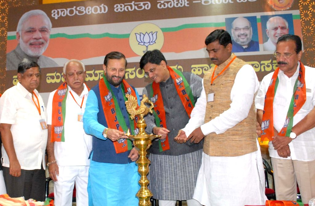 Union Human Resource Development Minister and BJP's Karnataka poll in-charge Prakash Javadekar lights the lamp during State Executive meeting in Bengaluru on Sept 16, 2017. Also seen BJP ... - Piyush Goyal