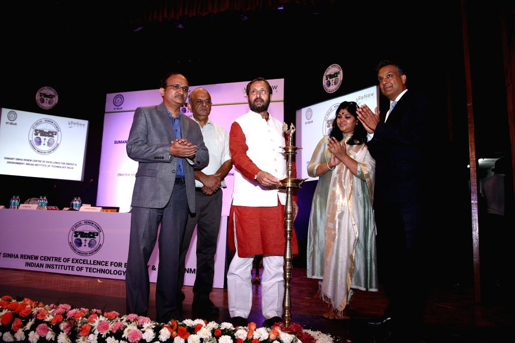 Union Human Resource Development Minister Prakash Javadekar lights the lamp during the launch of 'Sumant Sinha ReNew Centre of Excellence for Energy and Environment' by ReNew Power in ... - Prakash Javadekar and Sumant Sinha R