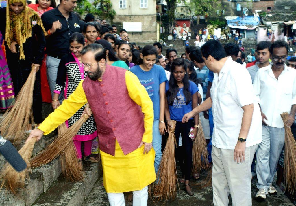 Union Human Resource Development Minister Prakash Javadekar participates in a cleanliness drive at the 'Swachhta Hi Sewa' campaign in Mumbai on Sept 17, 2017. - Prakash Javadekar