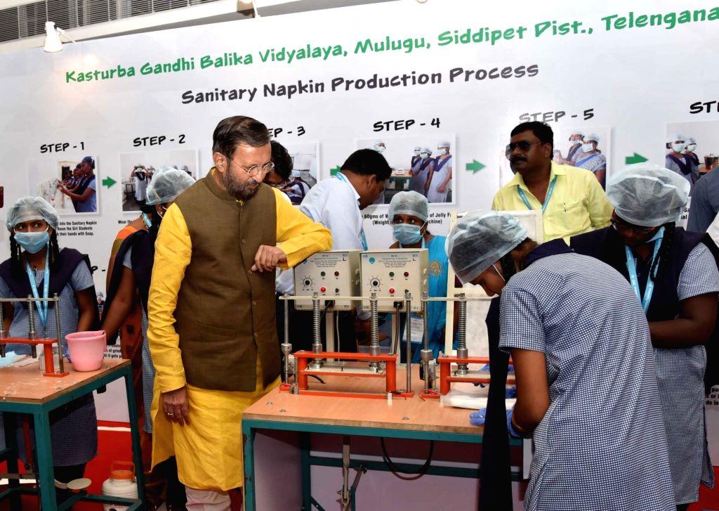 Union Human Resource Development Minister Prakash Javadekar looks at the sanitary napkin production process by the students, during the presentation of the Swachh Vidyalaya Puraskar ... - Prakash Javadekar
