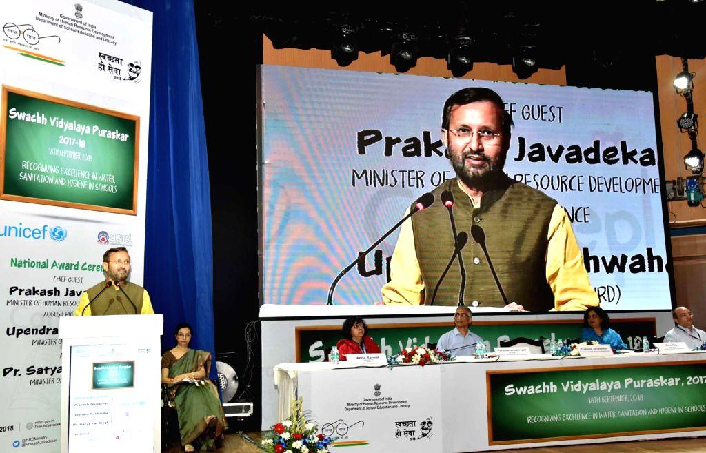 Union Human Resource Development Minister Prakash Javadekar addresses during the presentation of the Swachh Vidyalaya Puraskar 2017-18, in New Delhi on Sept 18, 2018. Also seen Ministry of ... - Prakash Javadekar