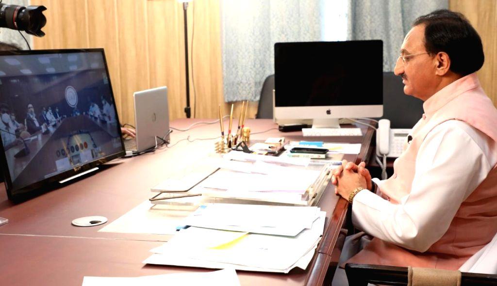 Union Human Resource Development Minister Ramesh Pokhriyal ???Nishank??? launches the COROSURE, COVID-19 Diagnostic Kit through video conferencing, in New Delhi on July 15, 2020. - Ramesh Pokhriyal