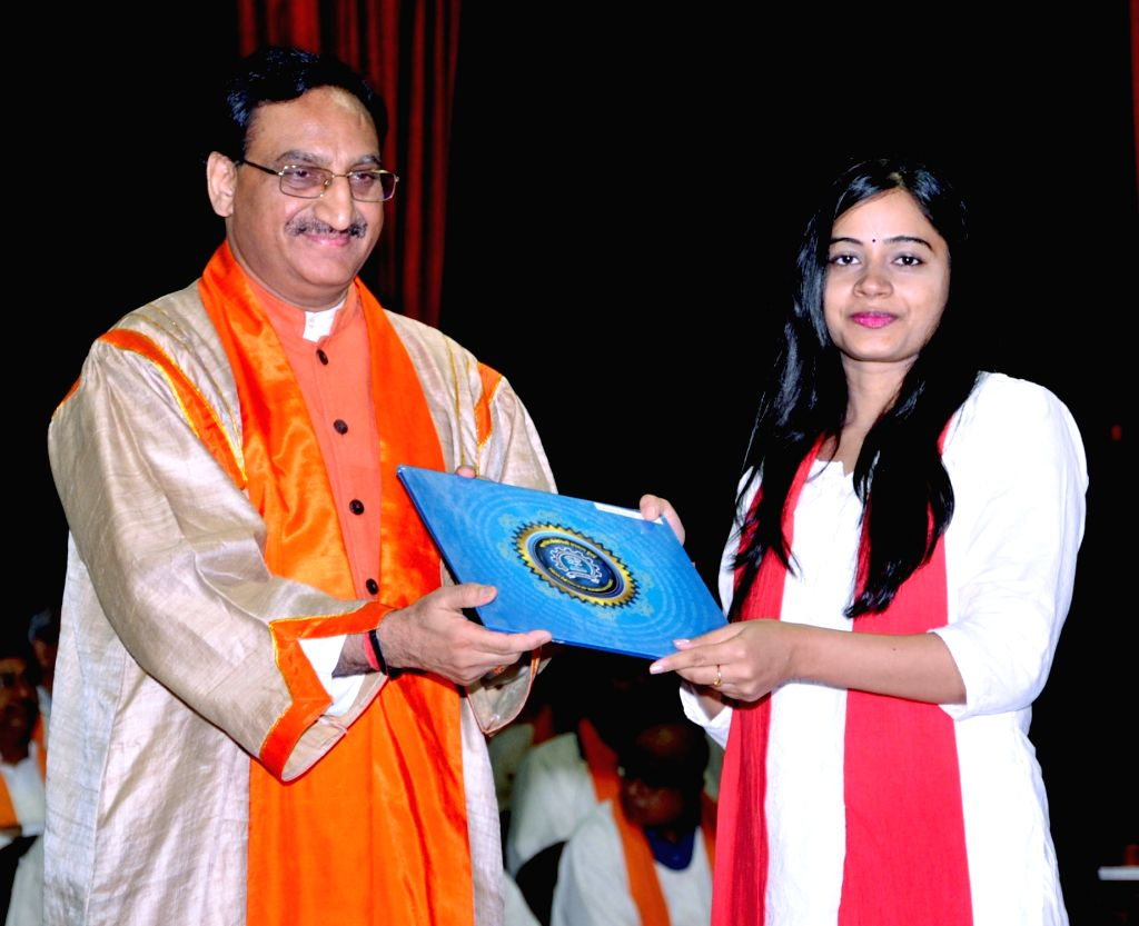 Union Human Resource Development Minister Ramesh Pokhriyal Nishank awards degree to a student, at the 57th convocation of Indian Institute of Technology, Bombay in Mumbai on Aug 10, 2019. - Ramesh Pokhriyal Nishank