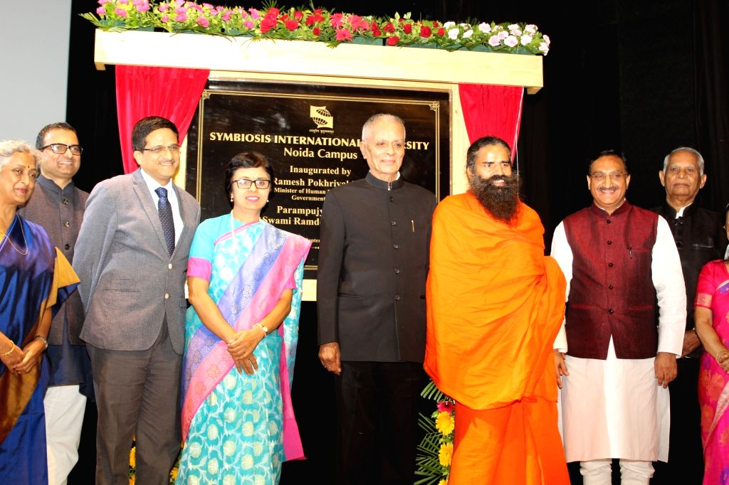 Union Human Resource Development Minister Ramesh Pokhriyal 'Nishank', Yoga Guru Baba Ramdev and Symbiosis International University Chancellor S. B. Mujumdar during the inauguration of the ... - Ramesh Pokhriyal