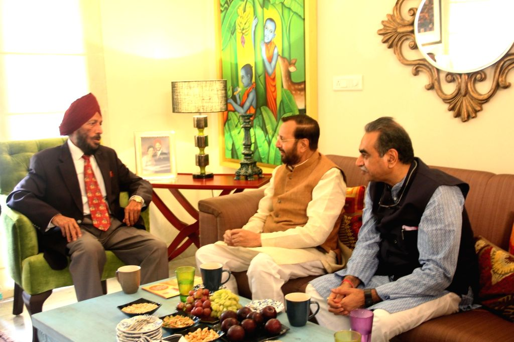 Union Information and Broadcasting and Environment, Forest, and Climate Change Minister Prakash Javadekar meets legendary track athlete Milkha Singh at his residence in Chandigarh, on Sep ... - Prakash Javadekar and Milkha Singh