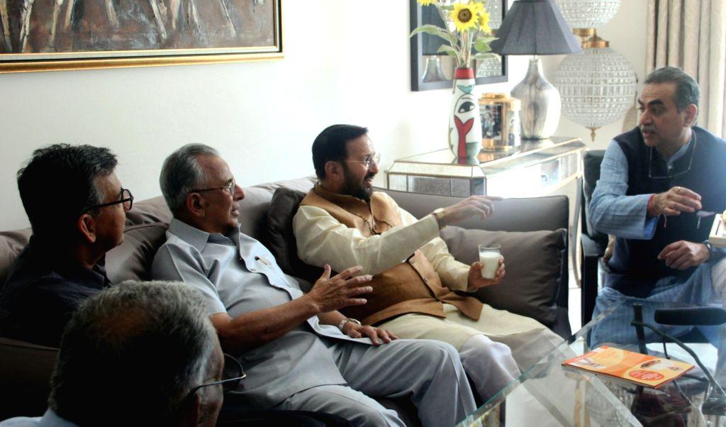Union Information and Broadcasting and Environment, Forest, and Climate Change Minister Prakash Javadekar meets Bharatiya Vidya Bhavan, Chandigarh Kendra Chairman R.K. Saboo, on Sep 4, ... - Prakash Javadekar