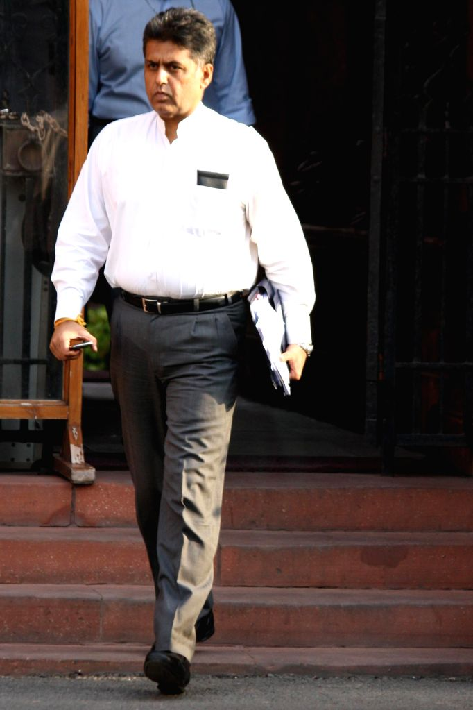 Union Information and Broadcasting Minister Manish Tewari comes out after the last cabinet meeting of UPA-II government in New Delhi on May 13, 2014. - Manish Tewari