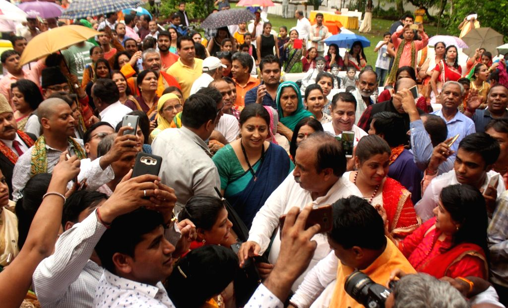 Union Information and Broadcasting Minister Smriti Irani participte during a programme organised to celebrate Teej festival at her residence in New Delhi on July 25, 2017. - Smriti Irani