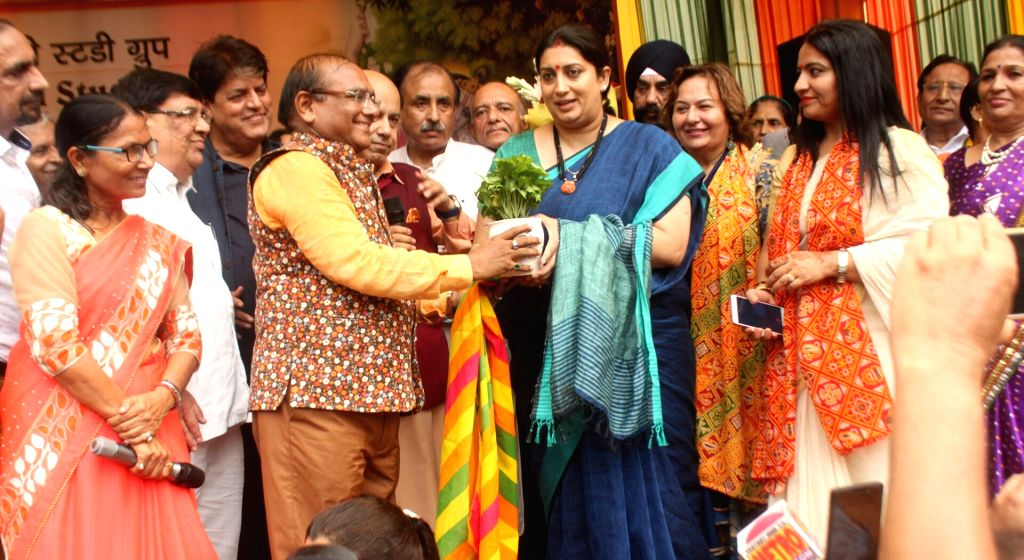 Union Information and Broadcasting Minister Smriti Irani participte during a programme organised to celebrate Teej festival at her residence in New Delhi on July 25, 2017. Also seen BJP ... - Smriti Irani