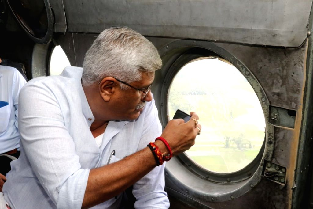 Union Jal Shakti Minister Gajendra Singh Shekhawat undertakes an aerial survey to take stock of the flood situation in Assam, on July 16, 2019. - Gajendra Singh Shekhawat