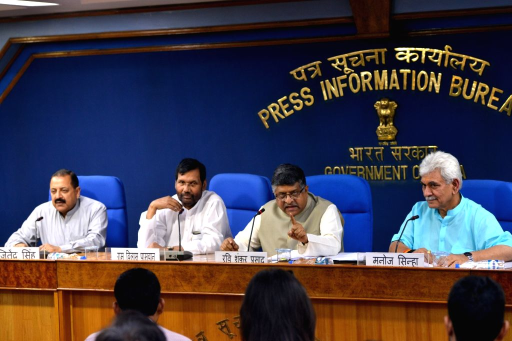 Union Law and Justice and Electronics and Information Technology Minister Ravi Shankar Prasad along with Union Ministers Jitendra Singh, Ram Vilas Paswan and Manoj Sinha, addresses a press ... - Ravi Shankar Prasad, Ministers Jitendra Singh, Ram Vilas Paswan and Manoj Sinha