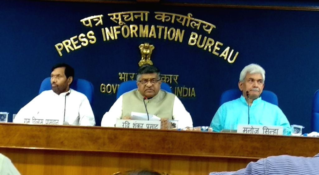 Union Law and Justice and Electronics and Information Technology Minister Ravi Shankar Prasad along with Union Consumer Affairs, Food and Public Distribution Minister Ram Vilas Paswan and ... - Ravi Shankar Prasad and Manoj Sinha