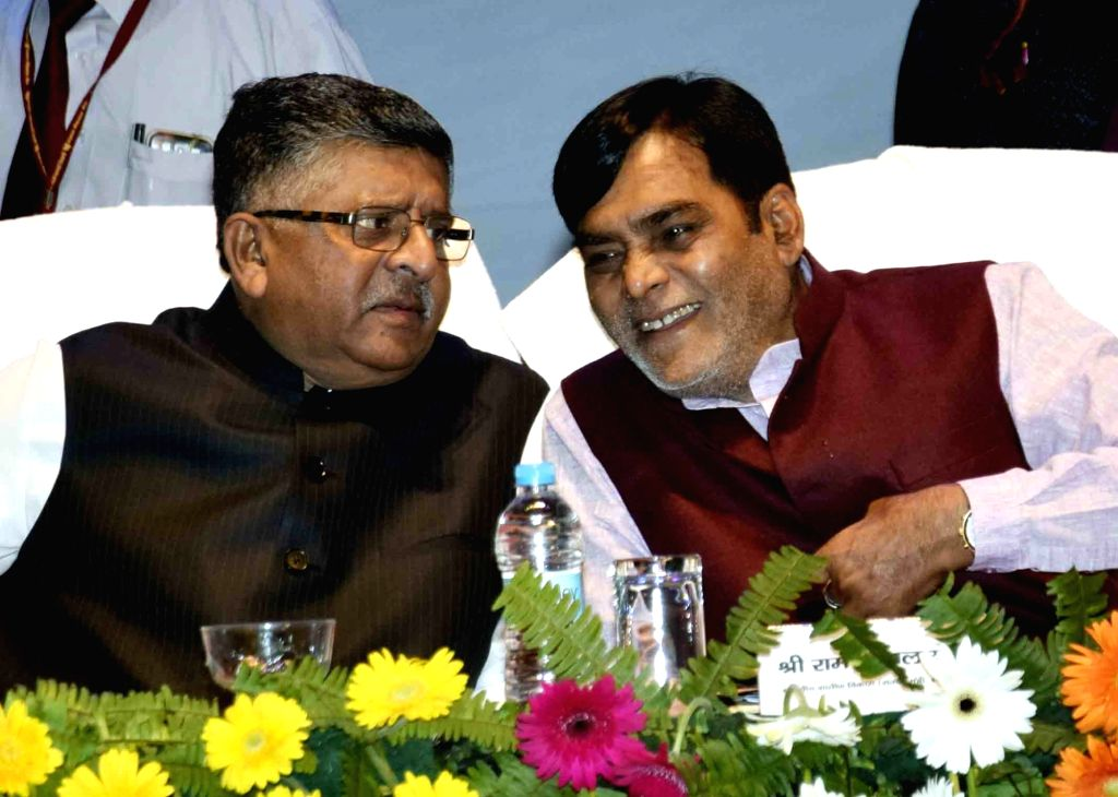 Union Law and Justice and Electronics and Information Technology Minister Ravi Shankar Prasad in a conversation with Union MoS Rural Development Ram Kripal Yadav during a programme in Patna, ... - Ravi Shankar Prasad