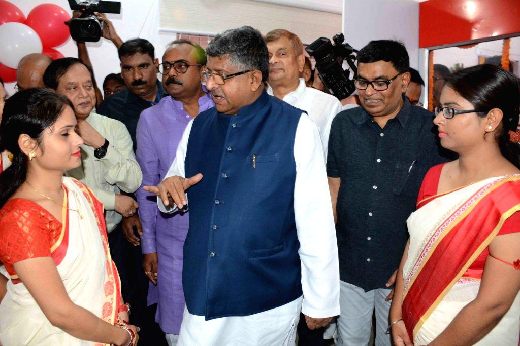 Union Law and Justice, Communications and Electronics and Information Technology Minister Ravi Shankar Prasad interacts with the employees of a newly inaugurated all-women post office, at BPSC ... - Ravi Shankar Prasad
