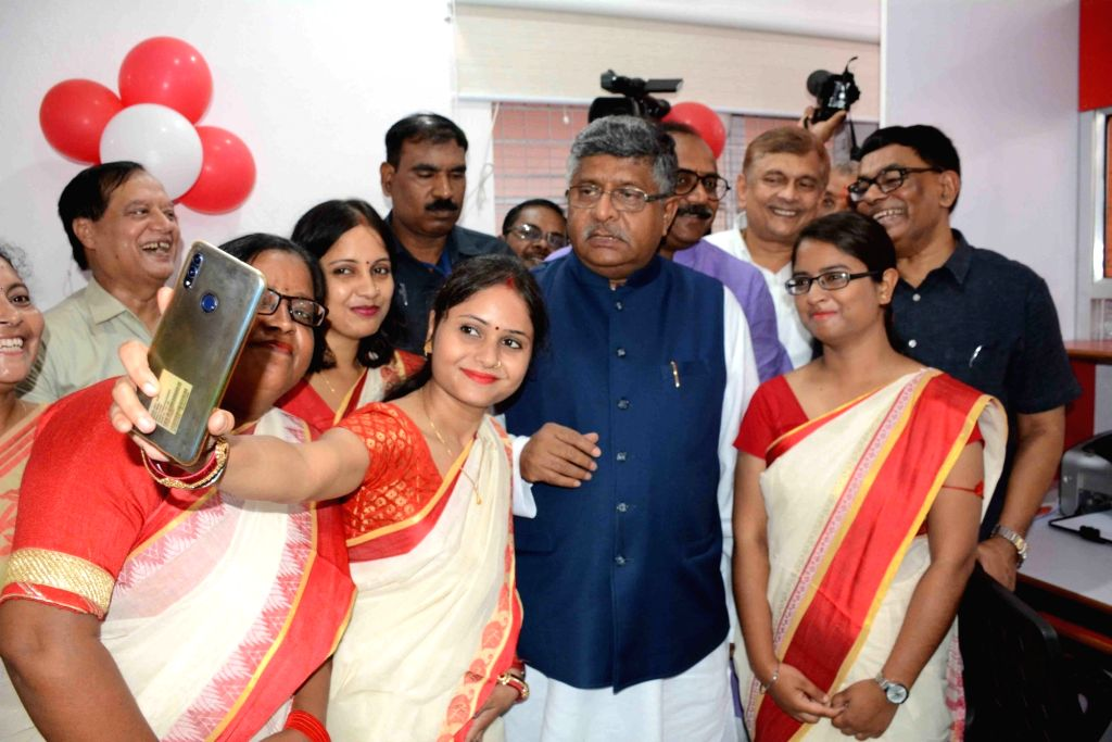 Union Law and Justice, Communications and Electronics and Information Technology Minister Ravi Shankar Prasad poses for selfies with the employees of a newly inaugurated all-women post office, ... - Ravi Shankar Prasad